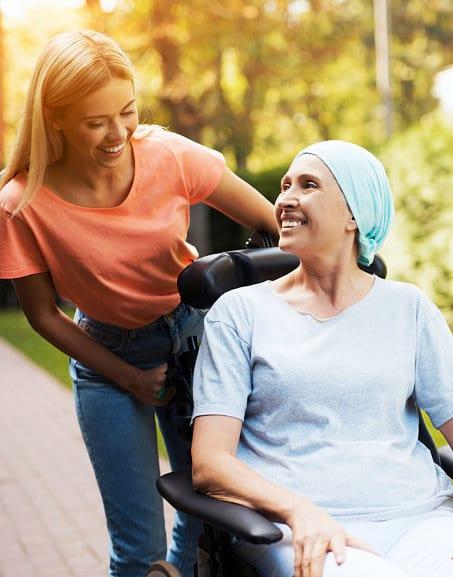 caregiver assiting woman in a wheelchair