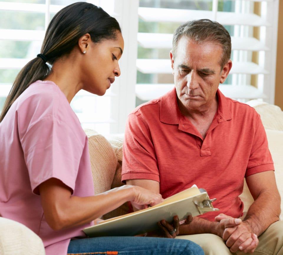 caregiver asking question to senior man